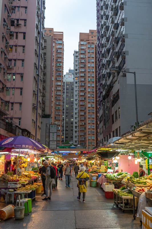 Hong Kong-Mong Kok - Here is a market. The towering apartments make it more interesting. I really dont mind the smell of durian, some people cant stand it. Maybe I just ha