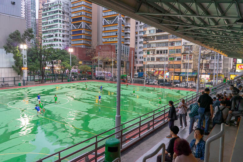 Hong Kong-Mong Kok - I stopped to take in a senior citizens soccer game played on wet concrete under lights. Awesome.