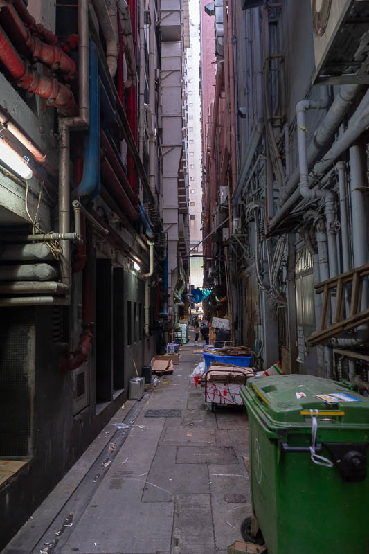 Hong Kong-Mong Kok - Laneways between the buildings are where it all happens, generally chefs smoking.