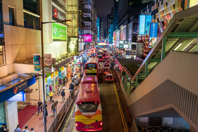 Hong Kong-Mong Kok - And shot 3 of 3 with many double decker buses. They are noisy and expel a gaseous blast of super heated air.