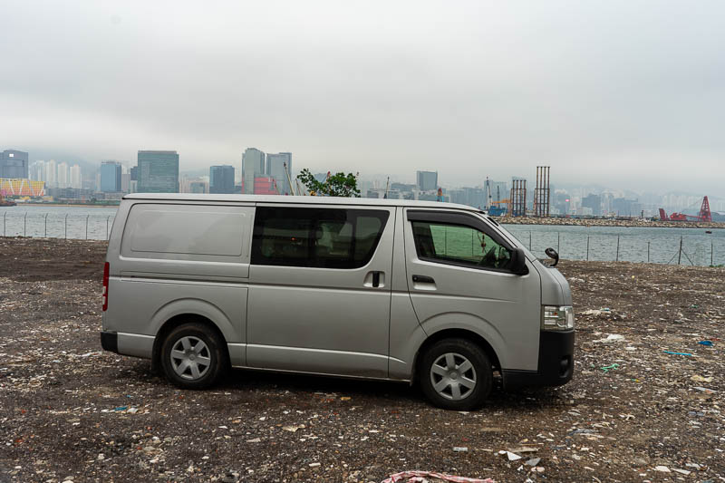 Hong Kong-Kowloon - I thought I found a way back to the water, instead I found this van abandoned in a field fall of churned up rubbish.