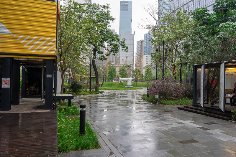 Hong Kong-Kowloon - I stopped for a late second coffee and watched the rain, and a sewing themed park in the newly re developed area of Kwun Tong. It seems to be an area