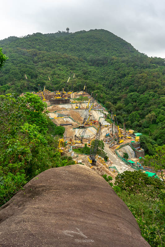 Hong Kong-Hiking-Lion Rock - That is a construction site being built into the side of a hill.