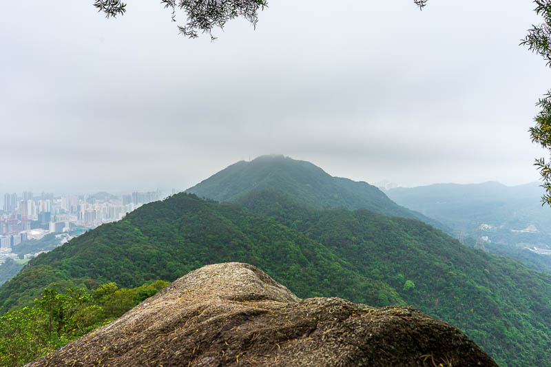 Hong Kong-Hiking-Lion Rock - Half way up the rock part of lion rock looking back at beacon hill. The Beacon has since vanished in the fog.