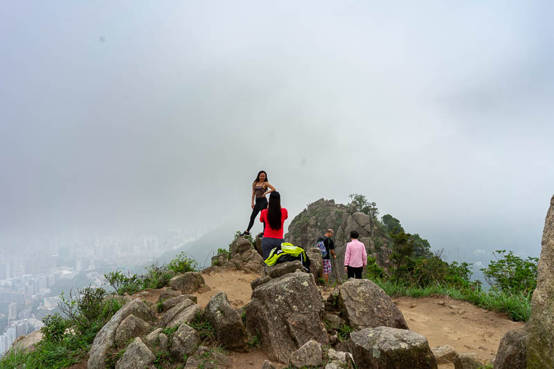 Hong Kong-Hiking-Lion Rock - These Filipino girls are trying their best to die posing for photos.