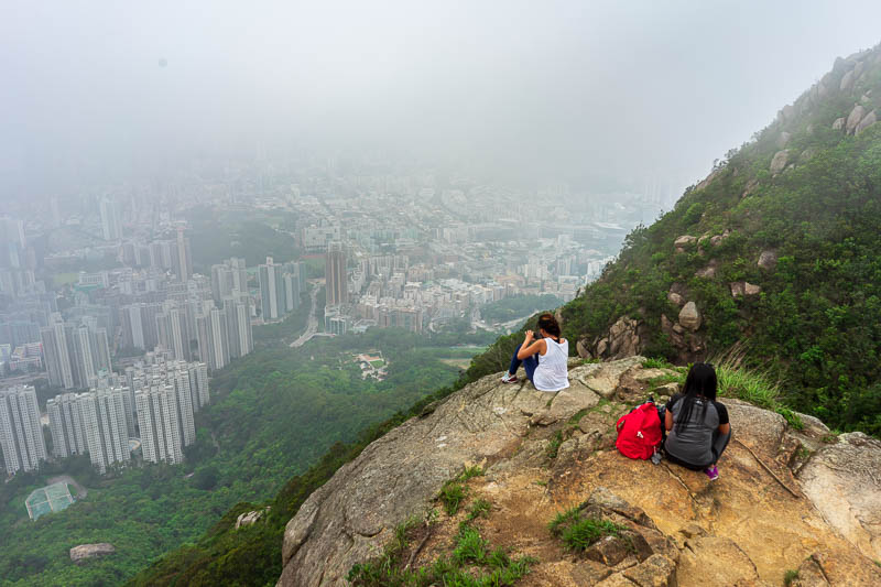 Hong Kong-Hiking-Lion Rock - More Filipinos perched on the edge. I am starting to understand why they need the signs everywhere telling people not to go on the official hiking tra