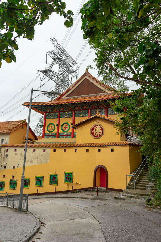 Hong Kong-Hiking-Lion Rock - Last photo, a temple! This one features razor wire, swastikas, and a huge power pole thingy. Soon after this, it started raining hard, literally minut