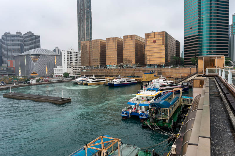 Hong Kong-Kowloon-Rain - Here are some actual ferries, their terminal is made of solid gold.