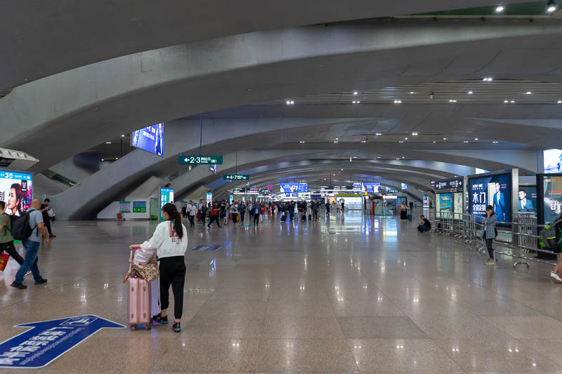 China-Hong Kong-Guangzhou-Train - The station is absolutely enormous and new. It is connected to the metro. I had no issue getting cash out and getting a Guangzhou metro card. It is ab