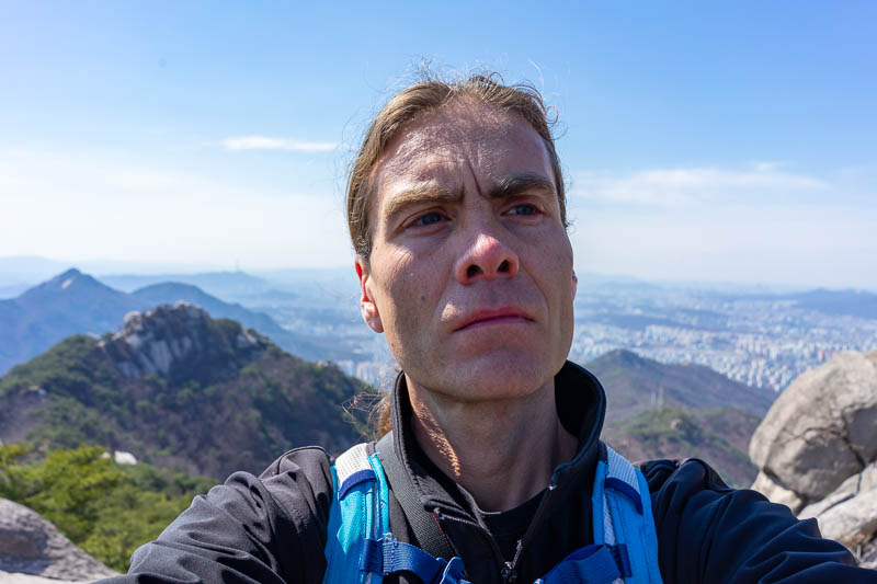 Korea-Hiking-Suraksan - The lines on my face look particularly deep today. I am starting to look like 90 year old Clint Eastwood. Here you can see my running backpack. I have