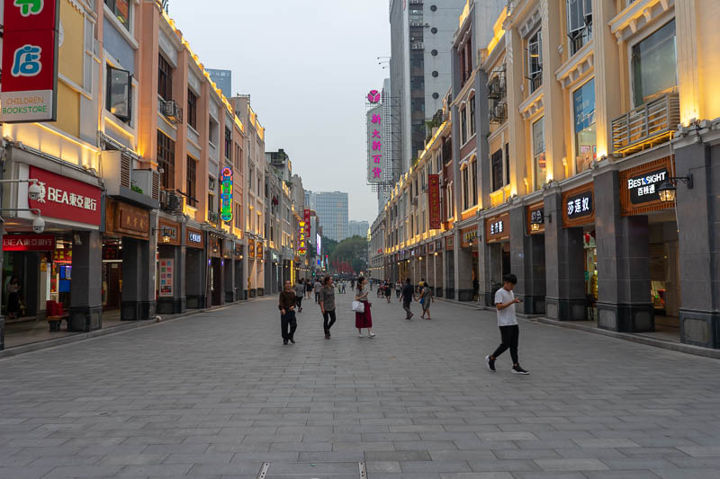 China-Guangzhou-Pasta - This street is the weather gauge. Last night it was used for sun, yesterday morning flood, before that mist. Tonight it is used for hazy sun at dusk.