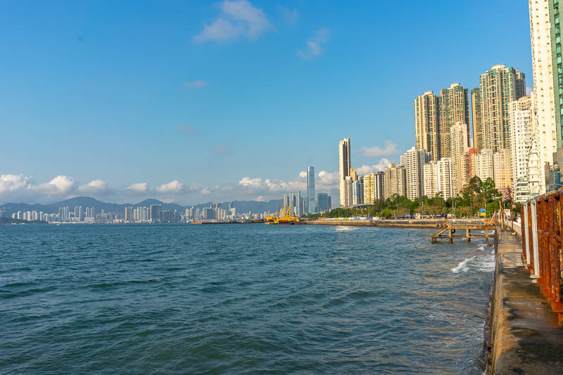 Hong Kong-Tram-Curry - Here is the view back along the coast. Nice clear skies. My camera is struggling with the white buildings again. The histogram does not show any clipp