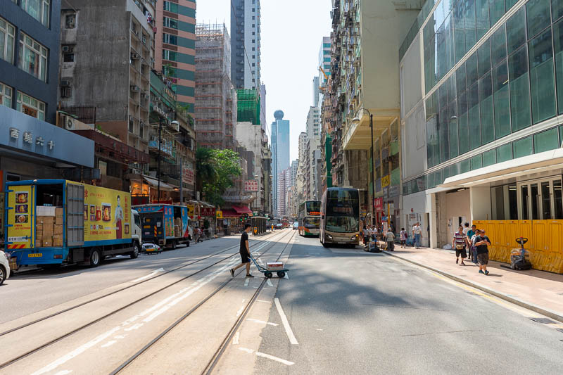 Hong Kong-Airport - And here is one last photo of a typical Hong Kong street, featuring guy with delivery trolley. All the guys pushing these aim them at my shins.