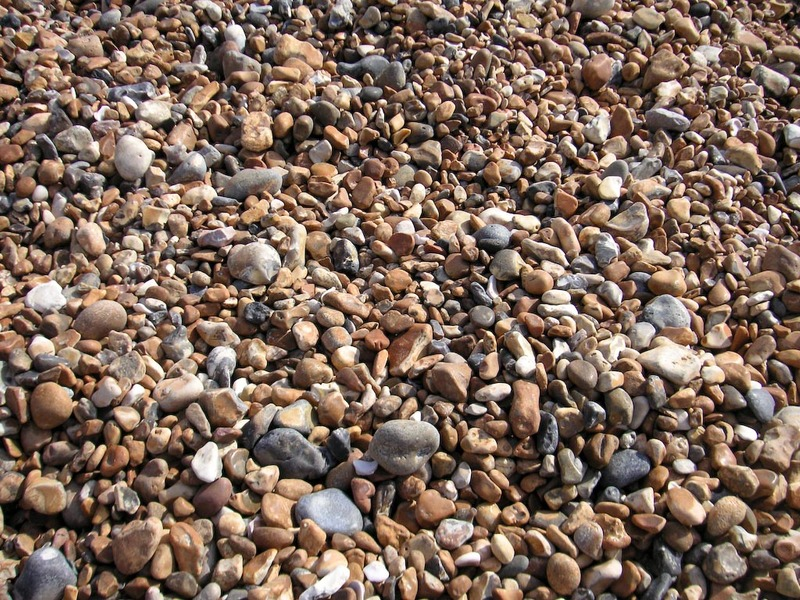 England-Brighton-Jetty-Beach - Welcome to the beach, stretch out and relax on a sea of rocks.