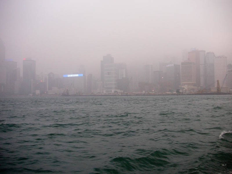 Hong Kong-Star Ferry-Smog-Tsim Sha Tsui - Hong Kong island through the smog.