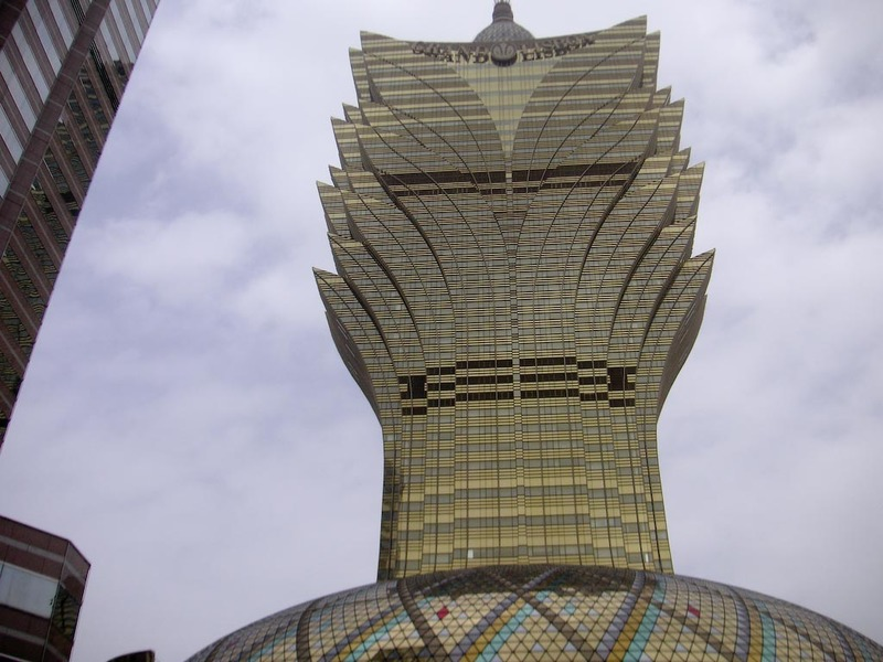 Macau-Casino-Ferry-Custard Tart - The terrifying Lotus flower casino building, looks to me like it could topple at any time.