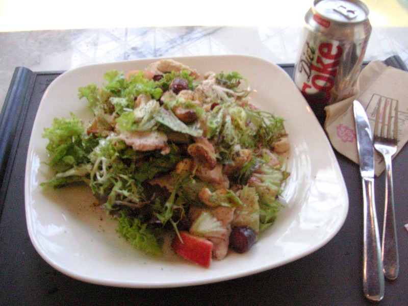 England-London-Mall-White City - Here is my lunch, a very nice salad, it had chicken on mixed leaves with cranberries, apple, grapes and cashews (sounds a bit weird but was really nic