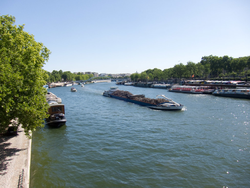 France-Paris-Arc de Triomphe-Eiffel Tower - The river sane, complete with garbage barge.