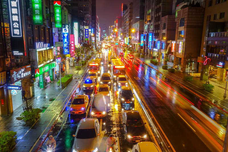 news - Here is a photo of Taipei, in the rain. The theme of this trip was rain. I remember some bemused locals looking at me like I was a lunatic for standin