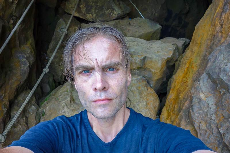 news - Here I am, in a cave, on teapot mountain near Jiufen, after being caught in a force 10 hurricane typhonic gale forced blast. I literally got sand blas