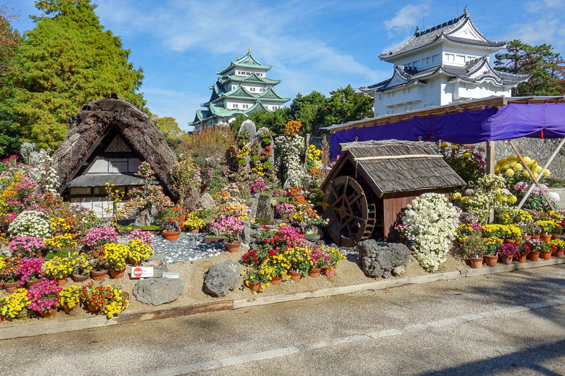 news - Nagoya has a great fake castle. Another day with excellent very overly colorful fake looking photos. The flower show in the castle grounds was excelle