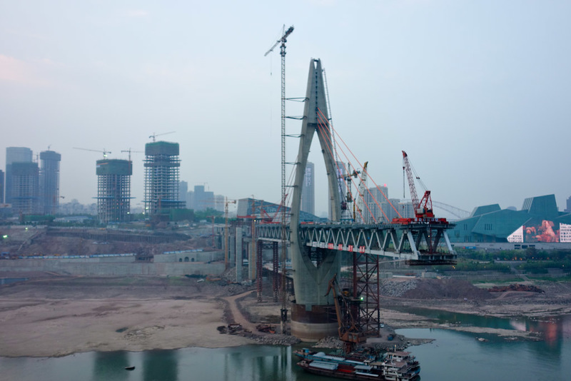 China-Chongqing-Jiefangbei-Architecture - This blew my mind. The scale of this is not really understood in the photo. Its a double decker bridge for a start. Its probably a hundred metres off