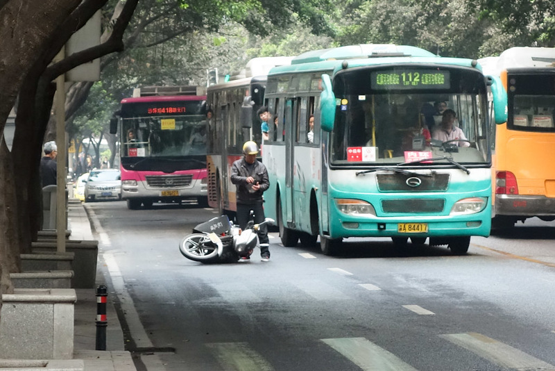 China-Chongqing-Eling Park-Fog - Bus vs motorcycle. Bus Wins! The number of accidents is still high in Chongqing even though scooters are banned. However for every accident I see, I n