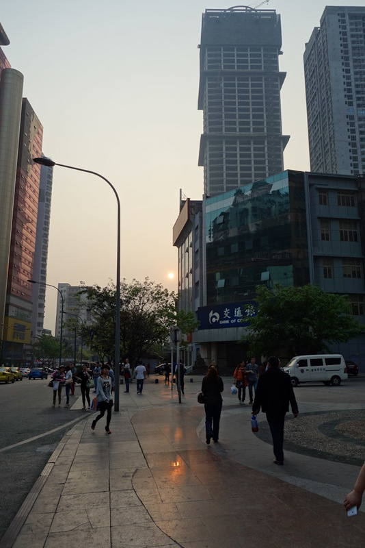 China-Chongqing-Nanping-Starlight Plaza - Staring directly into the moon, no wait its the sun. Its hard to tell. With all the smog the sun is no brighter than the moon. If you looked into the