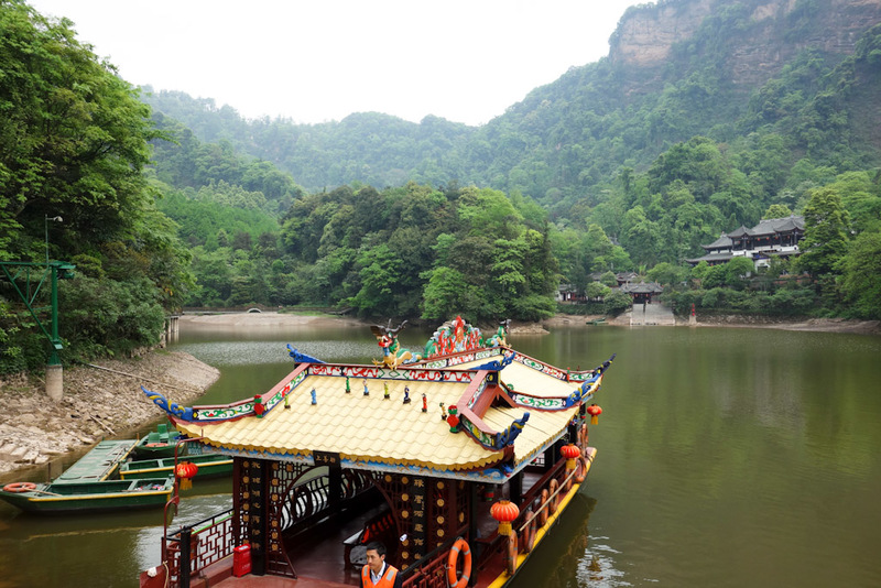 China-Hiking-Shrine-Qingcheng - Someones decided to invest in a boat. Look how far it takes you. It took all of 2 minutes to walk around this lake.