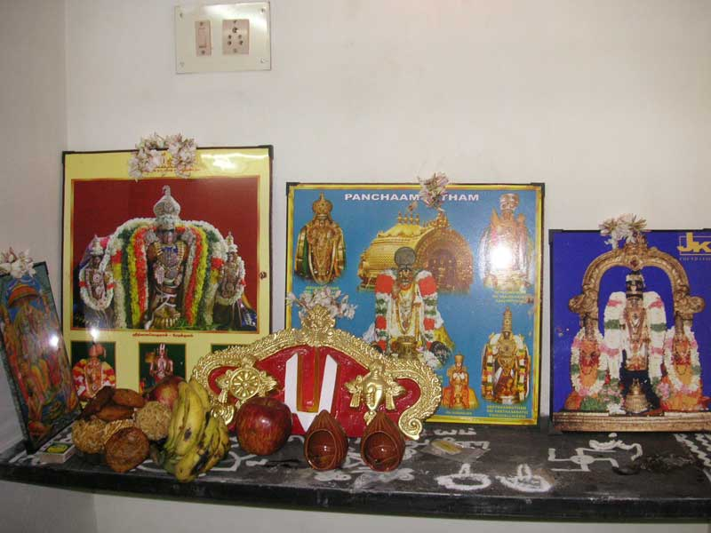 India-Chennai-Temple - The temporary prayer area inside the house, with food offered to the gods.