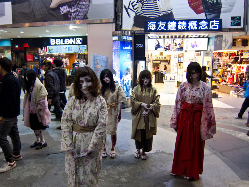 Taiwan-Taipei-Ximending-Taipei - OK, its time for Zombie cosplay geisha girls. They sort of sway slowly like zombies. They dont do anything else.