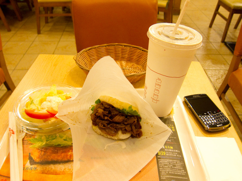Taiwan-Taipei-Ximending-Taipei - And this is my meal from Mosburger, the japanese burger chain. I have got a something something beef rice burger. The bun is made of rice, not bread.