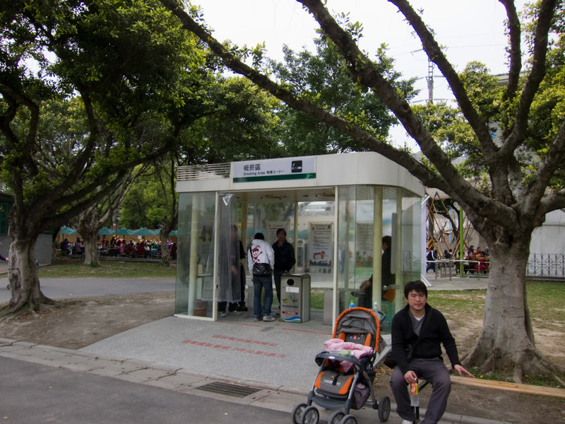 Taiwan-Taipei-Floral Expo-Danshui - All over Taipei you find smoking booths like these. Get into your booth filthy smokers! Smoking is generally banned outdoors as well as in. So they pu