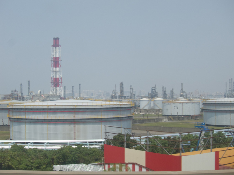 Taiwan-Taipei-Kaohsiung-Bullet Train - Welcome to Kaohsiung, enjoy our oil refinery.