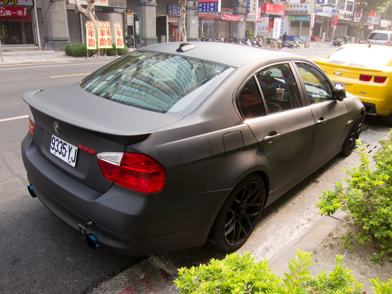 Taiwan-Kaohsiung-Bullet Train - This BMW is completely covered in Carbon Fibre vinyl, with red badges, blue exhaust pipes etc. I havent really seen any other car culture stuff in all