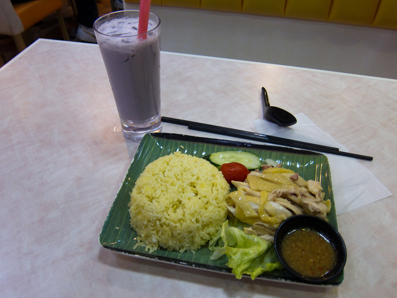 Hong Kong-Market-Mong Kok - And heres what I ate. Boneless Hainan chicken with Taro Milk tea. The chicken was ok, pretty fatty tasting. The rice was really good though, had been