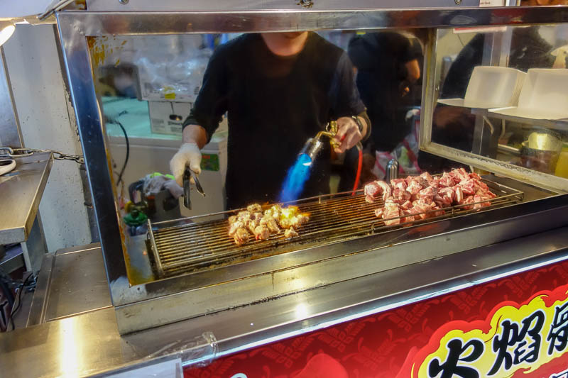 Taiwan-Taipei-Ximending-Ramen - Blow torch beef is back! Its small cubes now in a box, not as good as the time I saw a whole steak get blow torched and shoved in a paper bag.