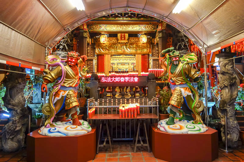 Taiwan-Taipei-Ximending-Ramen - This temple has LED scrolling screens, as many do, an ATM, as many do, and a new addition, god like warriors that shoot lasers from their eyes.