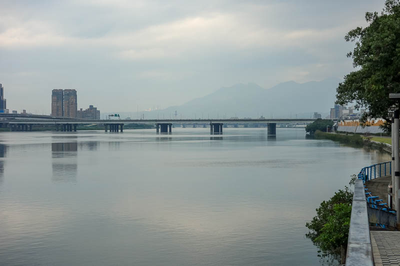 Taiwan-Taipei-Hualien-Bullet Train - My train wasnt until lunch time, so I had time to walk down to the river that runs through Taipei which is a long linear park. Nice mountain. I was up