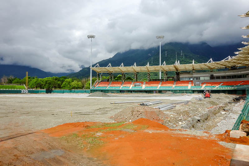 Taiwan-Hualien-Hiking-Rain-Zuocang - I climbed into one of the 3 baseball stadiums, the main one has a roof. This one is under reconstruction as you can probably see, although with my blu