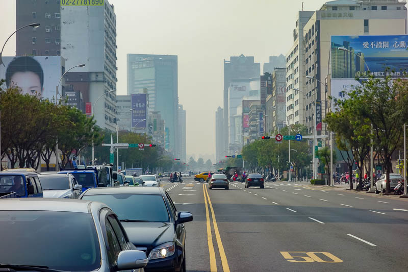 Taiwan-Kaohsiung-Monkeys-Temple-Beach - Tall buildings fading into dioxins.