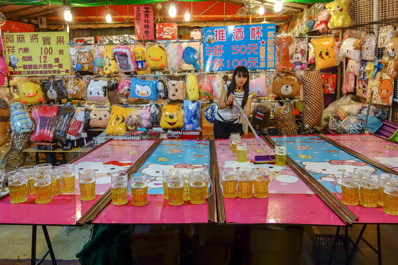 Taiwan-Kaohsiung-Night Market-Ruifeng-Food-Beef - Its a hello kitty drinking game. You pay money to drink x beers in y seconds, and if you win, you get a furry pillow toy.