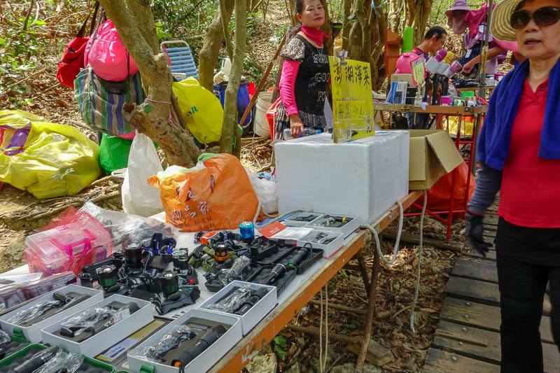 Taiwan-Kaohsiung-Hiking-Shoushan-Chaishan - The start of each trail has some stalls selling hiking equipment, boots, gloves, poles, head torches, and of course, small transistor radios to listen