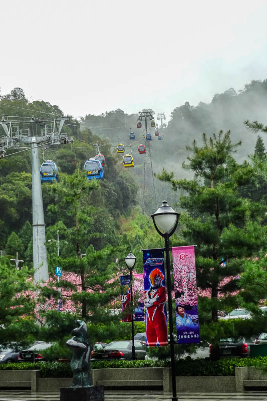 Taiwan-Sun Moon Lake-Rain - Ropeway cars disappearing into fog. No Asian tourist paradise is complete without a ropeway.