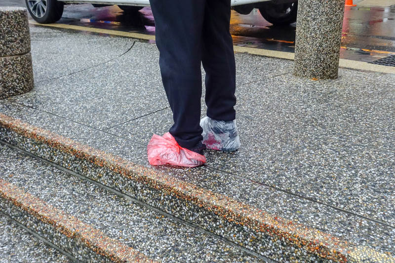 Taiwan-Sun Moon Lake-Rain - This guy is taking his shoes seriously.