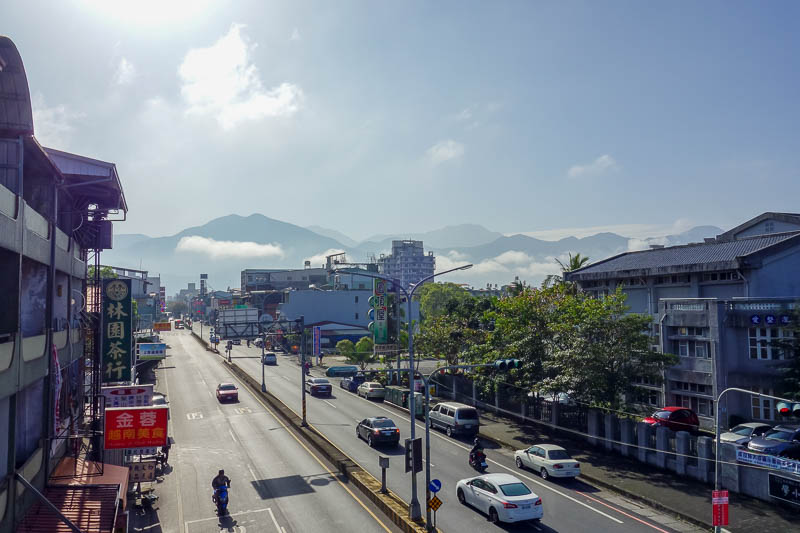 Taiwan-Puli-Taipei-Bullet Train - A well placed elementary school overpass gave me an opportunity to take a photo of the town and the mountains. Parents crossing with their children we