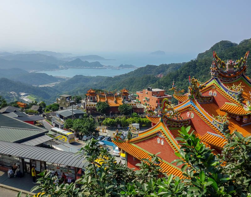 Taiwan-Jiufen-Hiking-Teapot Mountain - One last photo of the view, this time with temples and an island. On a clear day it would be awesome.