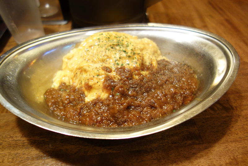 Japan-Tokyo-Nakano-Shinjuku-Omurice - My dinner is Japanese style curry with a rice filled omelette. It was quite good, but not spicy enough. I was longing for the curry I had in Kobe. The