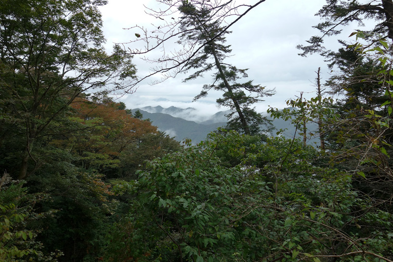Japan-Tokyo-Hiking-Mount Takao - Its mountains in every direction. I dont really see any towns or cities on the horizon except for Tokyo. Which if you ask me is the way countries shou