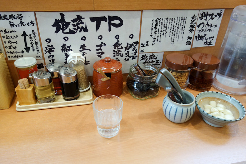 Japan-Tokyo-Shibuya-Rain-Ramen - My restaurant choice was made by the rain. This place has many condiments.